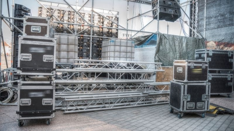an image of a screen being arranged for a concert