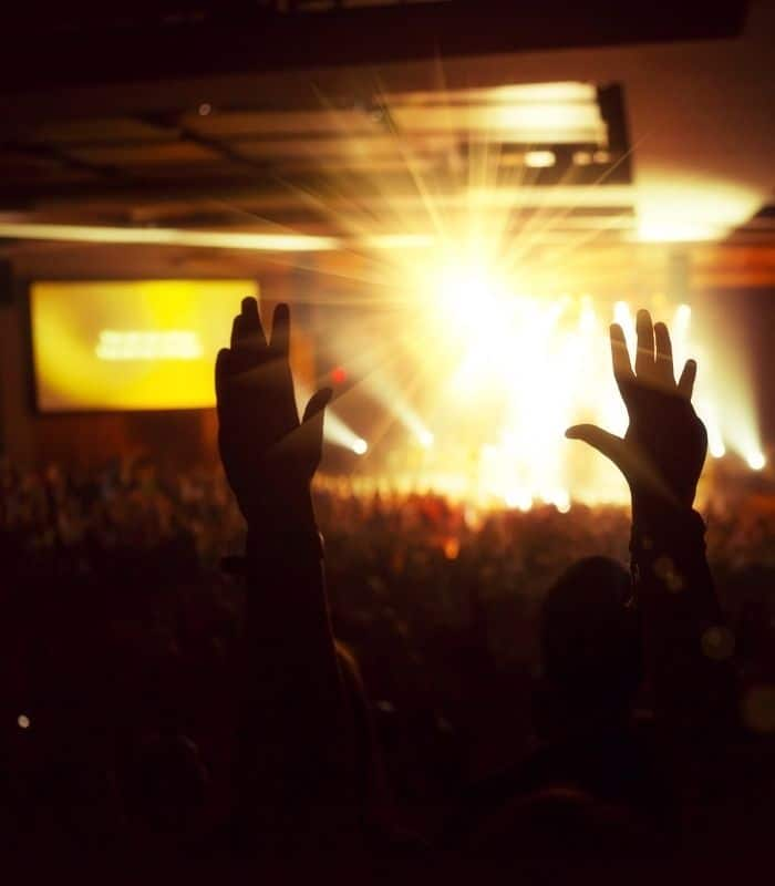 people gathered in a worship hall